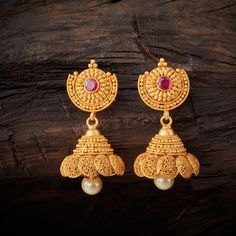 Conventional Designed Antique Jhumka Earrings studded with Ruby synthetic stones, with gold Polish. Gold Jhumka Earrings, Gold Earrings Designs, Antique Earrings, Gold Jewelry Simple, Jewelry Patterns, Gold Bangles, Jewelry Trends, Indian Jewelry, Fashion Jewelry