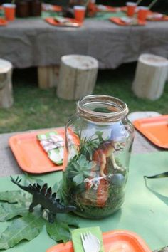 Mason jar centerpieces at a dinosaur birthday party! See more party ideas at CatchMyParty.com!