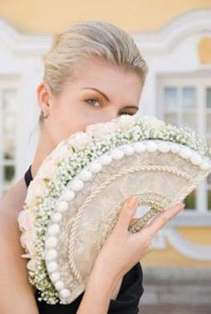 Here is another unique bridal bouquet ideas - a wedding flower fan to carry down the aisle.