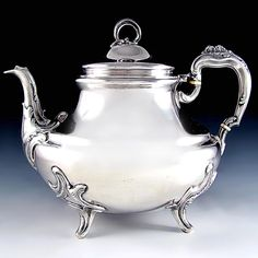 An elegant 19th century French sterling silver teapot made by Parisian silversmith L. Champenois, circa 1894-1895...