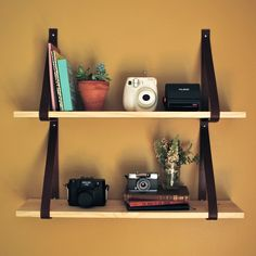 We had seen shelves like this on Pinterest and since we had a bare wall in the dining area, we figured we needed to make this. It's super...