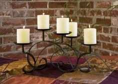 Contemporary / Transitional 5-Pillar CandleHolder at http://www.tuscanhomedecorandmore.com/large-contemporary-transitional-scrolled-iron-5-pillar-candleholder/