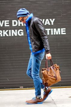 Shop this look on Lookastic:  http://lookastic.com/men/looks/beanie-sunglasses-gilet-bomber-jacket-jeans-tote-bag-socks-derby-shoes/5048  — Blue Horizontal Striped Beanie  — Black Sunglasses  — Blue Quilted Gilet  — Dark Brown Leather Bomber Jacket  — Blue Jeans  — Brown Canvas Tote Bag  — Black Print Socks  — Brown Leather Derby Shoes