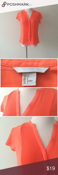 "H&M Neon Orange Silky button down Top Gently worn once. Accordion front. Button down top. Length 23.5"". Chest 19"" across. 100% polyester. H&M Tops"