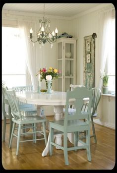 "Love the look of the white table with the pale blue chairs ... but every chair is unique.  (like this a lot better than every chair being a different color ... i.e. ""Friends"")"