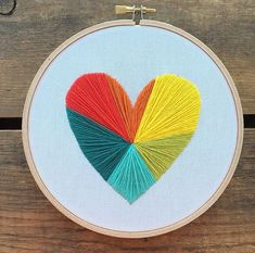 Rainbow Geometric Heart embroidery hoop art by bugandbeanstitching