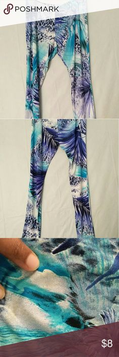 Blue Tropical Leopard Print Leggings This leggings have never been worn but they have a few stains on them. The pictures where I am pointing shows the stains. It it an XL but fits like a large. Pants Leggings