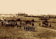 Mounted atop white horses, bandsmen of George Custer's 7th U.S. Cavalry (at left) joined infantry and artillery units on the parade ground found at Kansas's Fort Harker in 1867. This was not long before the band played as Custer's command made a devastating attack on the Southern Cheyenne at Washita. Some of these same men may well have played in the freezing cold during that 1868 Battle of the Washita.