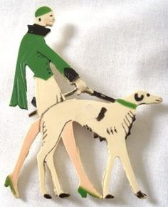 Lovely vintage 40s early celluloid lady & Afghan hound brooch. Sold for £36.00