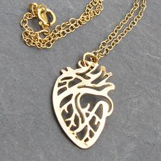 Gold plated anatomical heart pendant. Silver version also available. Classy, great gift.... in rhodium
