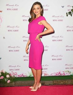 Miranda Kerr wears a Victoria Beckham dress during a public appearance to discuss her Royal Albert teaware in Sydney.