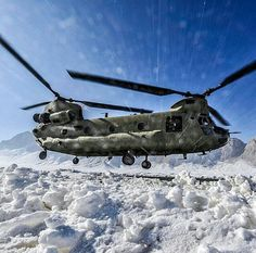A chinook landing in a snow
