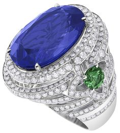 Orangerie des Tuileries ring from the Escale á Paris collection of jewels by Louis Vuitton featuring a large central Tanzanites, green tsavorites and diamonds.    Via The Jewellery Editor.