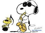 Snoopy with saxophone and Woodstock Peanuts by Charles Shultz