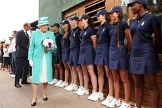 Queen Elizabeth II Photos - Queen Elizabeth II speaks to ball boys and girls as she attends the Wimbledon Lawn Tennis Championships on Day 4 at the All England Lawn Tennis and Croquet Club on June 24, 2010 in London, England. It is the first visit by Queen Elizabeth II to the Championships in 33 years. - The Queen Attends The All England Tennis Championships At Wimbledon