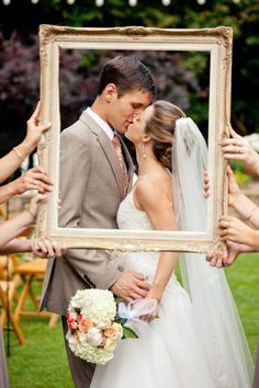 romantic love kiss wedding photo of bride and groom in photo frame