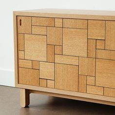 """Credenza in white oak with black resin inlay. At 56"""" long it's just the thing for a compact living room. It'll hold up your TV or store a couple of hundred LPs. #woodworking #furniture #cabinets #madeincanada #handmade #design"""