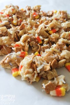 Candy Corn Cereal Snack Mix - sub cheerios, corn chex & vanilla chex (8 cups total). toasted coconut and slivered almonds