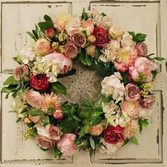 Bring welcoming appeal to your entryway or mantel with this charming faux floral wreath, featuring peonies, dahlias, and hydrangeas.
