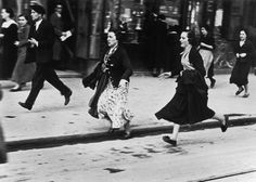 Basque region, Bilbao. Spain. Running for shelter during the air raids. By Robert Capa, (May 1937)