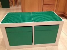 Ikea Expedit two cube unit, Ikea storage containers, two Duplo bases and two tubes of epoxy glue.... One super awesome Duplo table! My husband rocks!