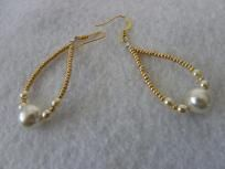 2 lg. Swarovski Pearls with 8mm, 8 pearl 4mm, with gold sliders to form a tear droop with gold plated ear wires of good quality.  One of a Kind.