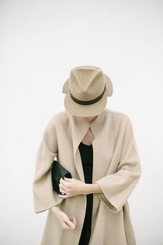 love the combination of camel and black. I think the coat is from Zara