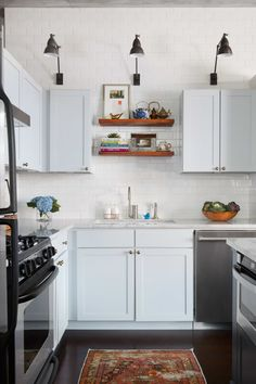 The combination of open and closed kitchen shelving is perfection.