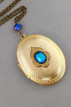 Heirloom Sapphire,Sapphire Locket,Vintage Necklace,Vintage Locket,Blue Opal Necklace,Vintage Opal,Vintage Rhinestone. ValleyGirlDesigns. by ValleyGirlDesigns on Etsy https://www.etsy.com/listing/179948258/heirloom-sapphiresapphire-locketvintage