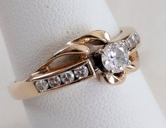 14k gold and .50 TW diamond ring, size 8 1/4 US, 9 stones by tlgvintageart on Etsy