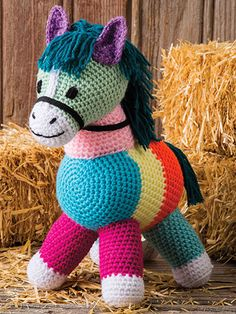 """Grab this sweet patchwork pony pattern before he gallops away! He'll trot right into your heart and make a home there for many years to come. Includes written instructions only. This e-pattern was originally published in the October 2016 issue of Crochet World magazine. Size: 15""""H. Made with medium (worsted) weight yarn and size 7/4.5mm hook. Skill Level: Easy"""