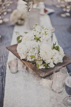 white flowers wedding tables display