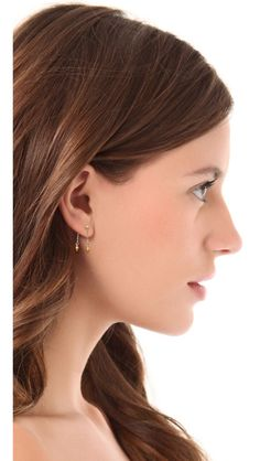 These delicate Petite Grand earrings have two hanging chains accented with pear-shaped pendants. Post closure. 14k gold fill. Made in Austra...