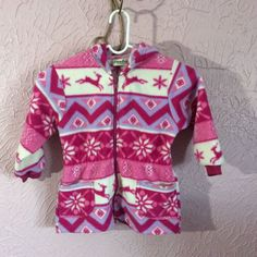 735496112 Toddler girls sweat jacket from Alpine Ridge. Pink, white and purple jacket  is hooded. Zip front with little front pockets. There are a couple little  black ...