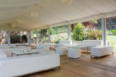 WHITE WEDDING LOUNGE. An all white lounge space for a wedding in a clear walled and silk lined ceiling marquee. #weddings #YourEventSolution