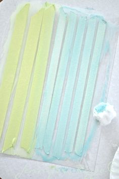 Making washi tape using drafting tape, acrylic paints, and a plastic sheet.