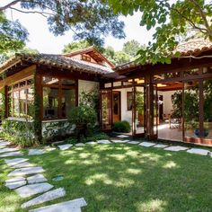 CH: playroom with wood windows feature Style At Home, Tropical Houses, Tropical House Design, Tropical Decor, Spanish Style, Spanish Revival, Spanish Colonial, House In The Woods, Traditional House