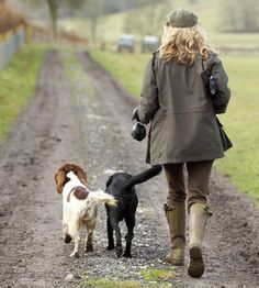Barbour Women's Sporting collection model walking with two dogs - my ideal life! Walks in the country with dogs. Mode Country, Country Walk, Town And Country, Country Girls, Country Living, Country Roads, English Country Manor, English Countryside, English Country Fashion