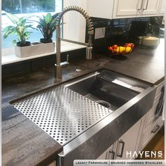 Black and white kitchens are a great way to achieve a modern, sleek look! This stunning example features the Legacy Farmhouse Sink with advanced sink accessories, including a drying rack and sponge caddy.   #whitekitchendesign #blackandwhitekitchen #farmstyledsimple #stainlesssteel #kitchenandbath #apronfrontsink Stainless Steel Farmhouse Sink, Copper Farmhouse Sinks, Stainless Steel Cleaner, Stainless Kitchen, Stainless Steel Types, Stainless Steel Sinks, Brushed Stainless Steel, Copper Sinks, Apron Front Sink
