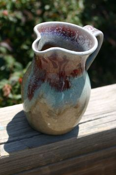 Salt Glazed Pottery Pitcher with Copper Glazed Rim.  via Etsy.