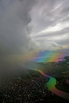 "Photographer states, ""Storm Clouds Edge (rainbow effect on water caused by polarized glass on plane and camera), taken from inside the plane coming home from a vacation in Boracay Philippines,"" All Nature, Science And Nature, Amazing Nature, Beautiful Sky, Beautiful World, Beautiful Pictures, Vida Natural, Belleza Natural, Storm Clouds"