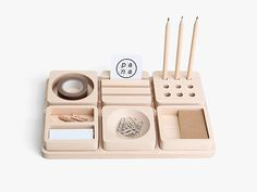 "tofu stationery set by pana objects, is a maple-wood tray set with six removable storage discs or ""dividers"". each individual wooden disc is designed with various sections or compartment(s) to better organize your stationery and small office supplies."
