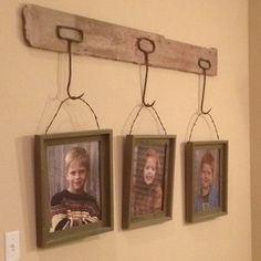 Rustic photo display! Reclaimed barn wood, hay hooks, barbed wire attached to frames makes for a unique wall hanging.