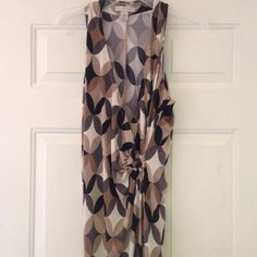 Dress Wrap dress w/Wooden ring that gathers on the side. Black, beige, and gray oval designs. Very comfy & flowy.  SMOKE FREE AND PET FREE HOME Jonathan Martin Dresses
