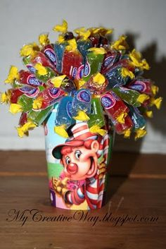 Candy Land - Candy Bouquet. I'm not sure if it has directions, but you can use a Styrofoam ball with hairpins holding one end of the wrapped candy in.  I'd definitely put some weight in the paper cup, since they will be top heavy. From - My Creative Way: Candy Land Party. Ideas.