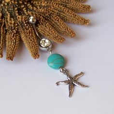 Beach themed belly button ring