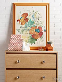 Update a thrifted piece of wall art for your home with geometric stitching.