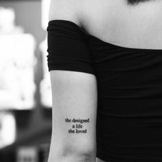"""""""She designed a life she loved"""" tattoo on the back of the left arm. Tattoo artist: Evan Kim"""
