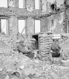 WWI, 17 July 1917; An advanced dressing station under a ruined house at Ecoust-Saint-Mein, showing the Royal Army Medical Corps Captain, decorated with a Military Cross, and an Officer of the Gordon Highlanders. ©IWM Q 5689