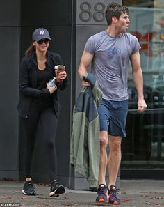 The couple that works out together...: Showcasing their toned bodies - as well as their love of keeping healthy - as they left a yoga session, the actress, 26, and her 30-year-old movie star beau appeared in high spirits.